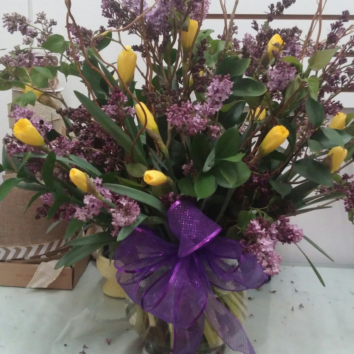 Lilac and daffodils arrangement with curly willow