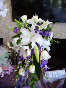 Rose, Lily, orchid cascade wedding bouquet